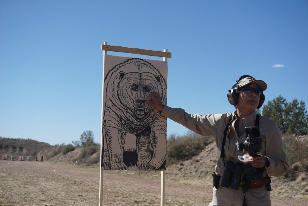 Gunsite instructor and professional hunter Il Ling New points out the ideal spot to put the brakes on a charging grizzly.